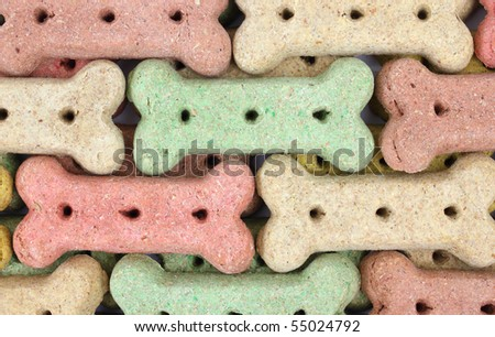 Several rows of different colored dog biscuits. - stock photo