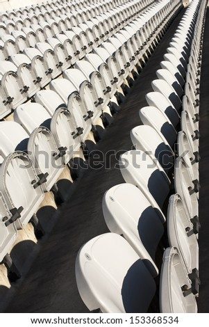 Several rows of white chairs - stock photo