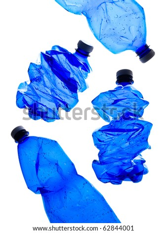 several rushed blue plastic bottles on the white background