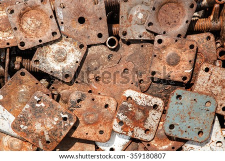 Several rusty iron sheet sizes.