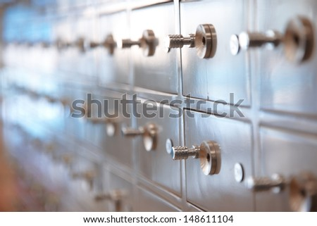 Several safes. Horizontal, closeup view with shallow depth of field - stock photo