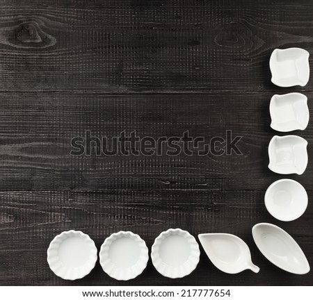 Several Sauce boat on black wooden rustic surface background top view - stock photo