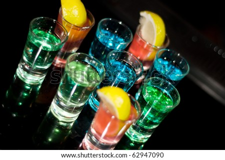 Several shots of different drinks at a party in a nightclub - stock photo