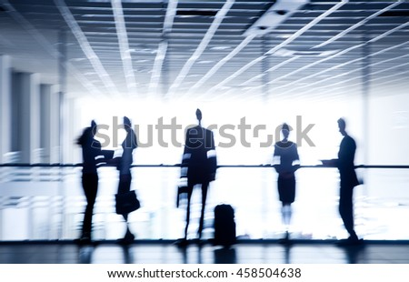 Several silhouettes of business-people interacting  background airport - stock photo