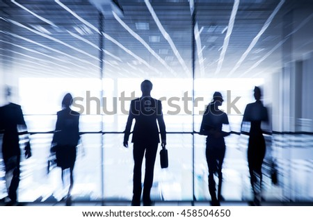 Several silhouettes of business people interacting office background - stock photo