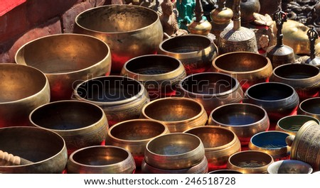 Several singing bowls displayed at a market in Kathmandu, Nepal - stock photo