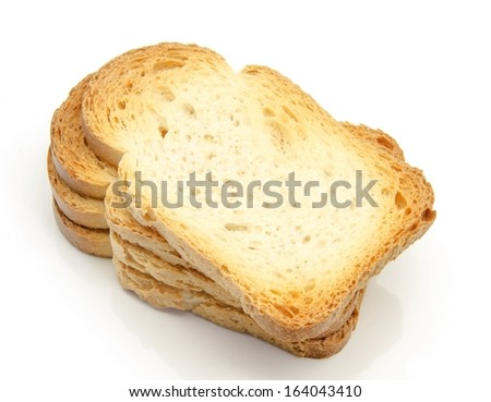 several slices toasted bread on white background