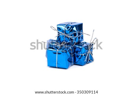 Several small blue boxes with gifts on a white background