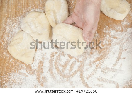 Several small patties with the potato filling - stock photo