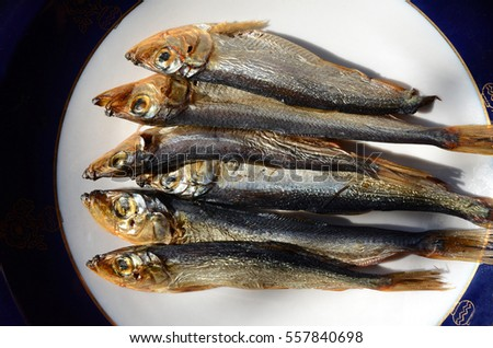 several small smoked fish on a plate, Horse mackerel