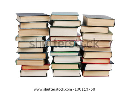 Several stacks of books on a white background - stock photo