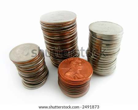 Several stacks of coins isolated on white background - stock photo