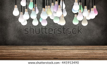 Several suspended light bulbs in front of a blackboard. Colored lights are powered on. Copy space available. 3D Rendering - stock photo