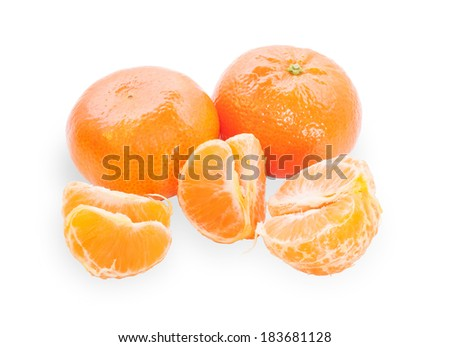 Several tangerines, one purified and separated into segments isolated on white background - stock photo
