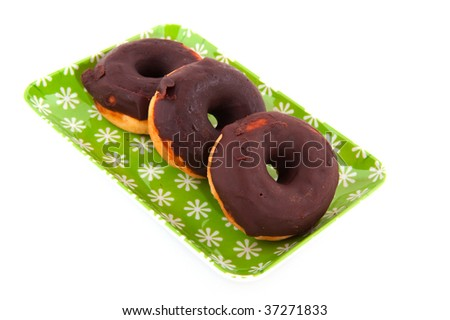 Several tasty chocolate donuts isolated over white