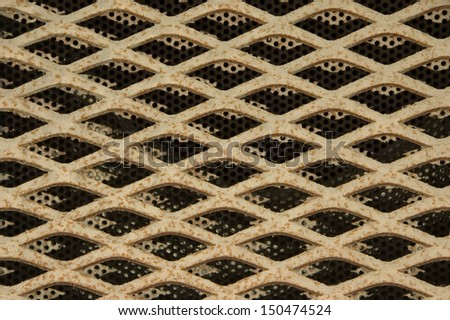 Several types of old metal grating placed one above each other.