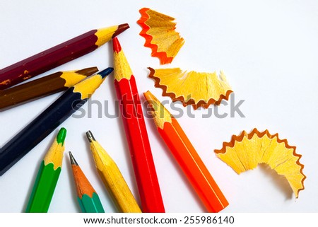 several vintage pencils and shavings on white background with copy space, close up - stock photo