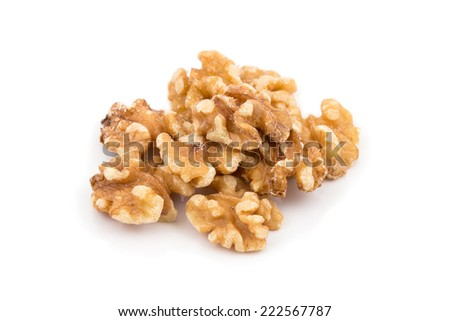 Several walnut kernels isolated against a white background