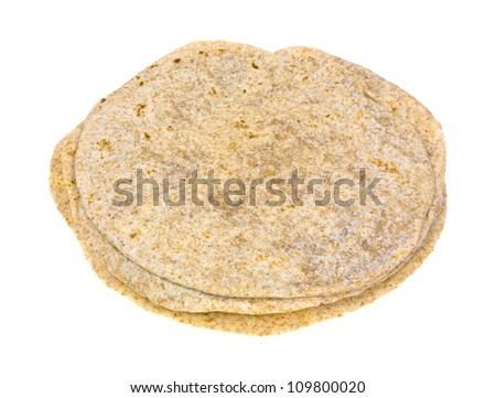 Several whole wheat tortillas in a stack on a white background.