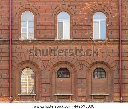 Several windows in a row on facade front view