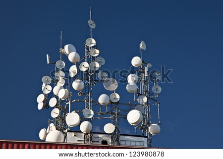 Several wireless, satellite and mobile phone antennas - stock photo