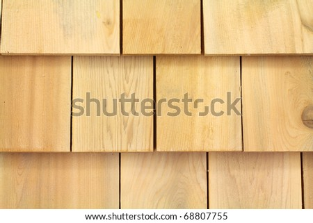 Several wood cedar shingles for siding or roofs. - stock photo