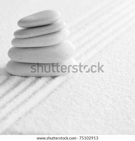 several zen stones on the sand background - stock photo