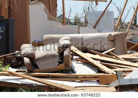 Severe damage to both structure and belongings by a powerful tornado punctuate the loss caused by severe weather and serve to remind us that, advanced as our race may be, we do not control everything. - stock photo