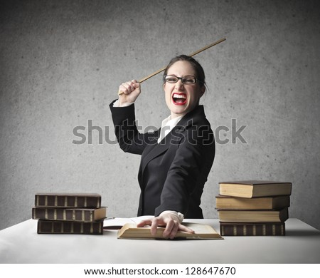 severe teacher screams with wooden stick in hand - stock photo