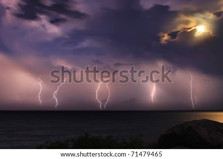 Severe thunderstorm over the ocean. Moonlight
