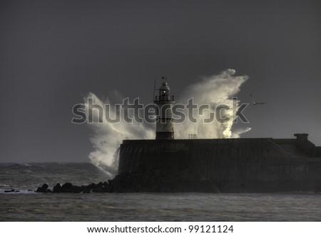 Severe weather batter sea defenses - stock photo