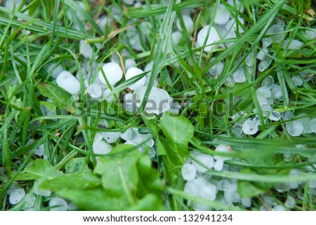 Severe Weather, hail on a grass - stock photo