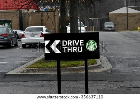 SEVERN, MD, USA - DECEMBER 30, 2015: Starbucks drive thru sign at a Starbucks location in Severn, MD. Starbucks Corporation is an American coffee company and coffeehouse chain. - stock photo