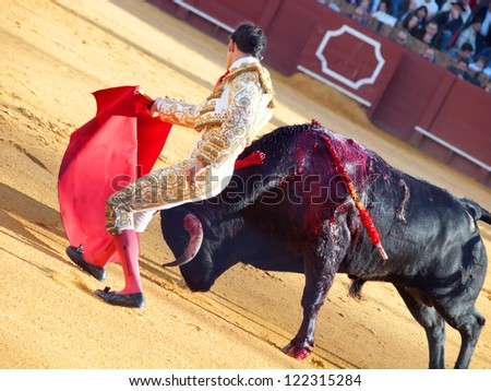 SEVILLA -MAY 20: Novilladas in Plaza de Toros de Sevilla. Novillero: Emilio Huertas. May 20, 2012 in Sevilla (Spain) - stock photo