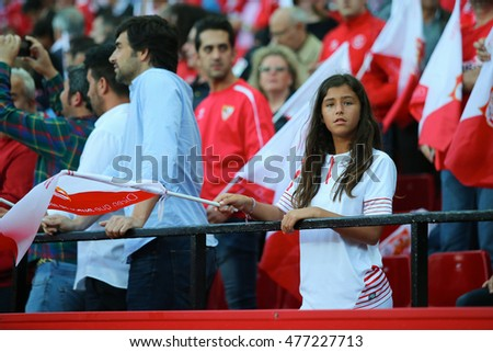 SEVILLA, SPAIN - MAY 5: Sevilla FC girl-fan stays on the stands with a flag during the UEFA Europa League second leg semi-finals match between FC Shakhtar Donetsk vs Sevilla FC, 5 May 2016, Spain