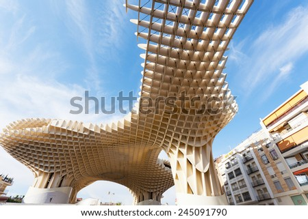 SEVILLA,SPAIN -SEPTEMBER 17, 2013 : Metropol Parasol in Plaza de la Encarnacion in Sevilla, J. Mayer H. architects, it is made from bonded timber with a polyurethane coating - stock photo