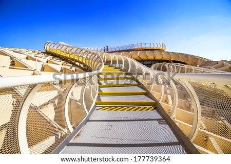 SEVILLA, SPAIN - SEPTEMBER 9: Metropol Parasol in Plaza de la Encarnacion on September 9, 2013 in Sevilla, Spain. J. Mayer H. architects, it is made from bonded timber with a polyurethane coating.  - stock photo