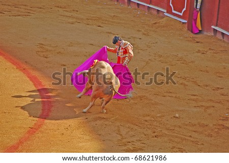 "SEVILLE - APRIL 30:  Bullfighter David Fandila ""El Fandi"" fights for a sold out crowd at the Plaza de Toros de Sevilla April 30, 2009 in Seville, Spain. - stock photo"