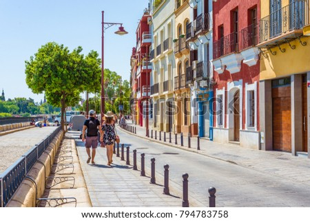 SEVILLE, ES - JULY 30, 2017: Betis Street in Seville is located on the banks of the river Guadalquivir, on the opposite side of the city center.