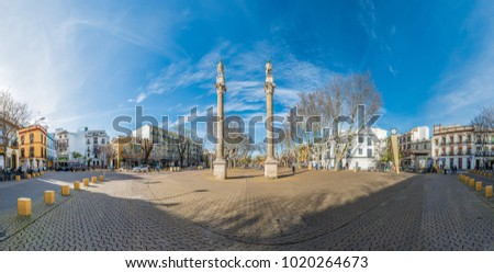 SEVILLE, ES - MARCH 6, 2017: The Alameda de Hercules is an important public garden located in Seville, and by its antiquity (1574) is classified as the oldest public garden in Spain and Europe.