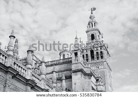 Seville in Andalusia, Spain. Giralda tower of famous cathedral. UNESCO World Heritage Site. Black and white photo.