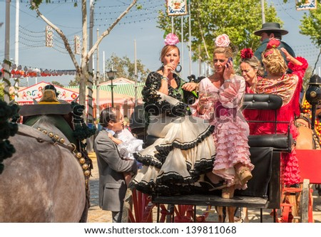 SEVILLE, SPAIN - APR, 25: Parade of carriages at the Seville's April Fair  on April, 25, 2012 in Seville, Spain - stock photo