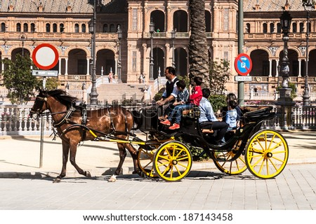 SEVILLE, SPAIN - APR 13, 2014: Unidentified tourists at the Plaza de Espana in Seville, Andalusia, Spain. It's example of the Renaissance Revival style in Spanish architecture.