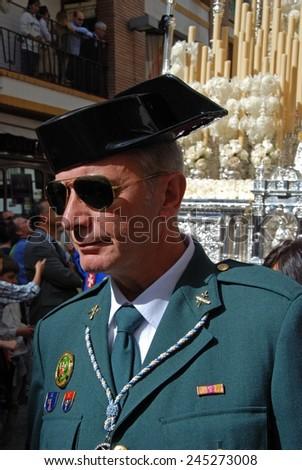 SEVILLE, SPAIN - APRIL 7, 2009 - Civil Guard Officer leading the San Esteban brotherhood procession through the city centre streets during Santa Semana, Seville, Spain, Western Europe, April 7, 2009. - stock photo