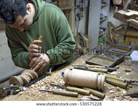 SEVILLE, SPAIN - APRIL 09, 2008: Craftsman, turn a piece of wood, into a workshop
