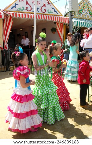 SEVILLE, SPAIN - APRIL 12, 2008 - Girls standing in front of a Casita in traditional dress at the Seville Fair, Seville, Seville Province, Andalusia, Spain, Western Europe, April 12, 2008.