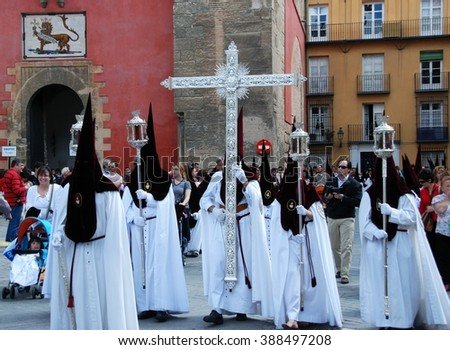 SEVILLE, SPAIN - APRIL 7, 2009 - Members of El Cerro brotherhood walking through the city streets during Santa Semana, Seville, Seville Province, Andalusia, Spain, Western Europe, April 7, 2009. - stock photo