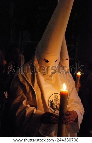 SEVILLE, SPAIN - APRIL 7, 2009 - Members of the Candelaria brotherhood at night during Santa Semama, Seville, Seville Province, Andalusia, Spain, Western Europe, April 7, 2009. - stock photo