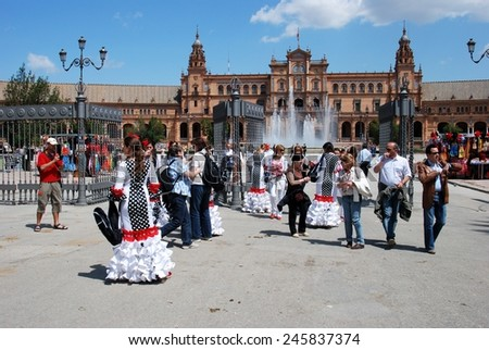 SEVILLE, SPAIN - APRIL 12, 2008 - Spanish women in flamenco dresses at the entrance to the Plaza de Espana, Seville, Seville Province, Andalusia, Spain, Western Europe, April 12, 2008. - stock photo