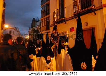 SEVILLE, SPAIN - APRIL 10: The Holy Week processions of Semana Santa climax during the early hours of Good Friday, April 10, 2009, in Seville, Spain.